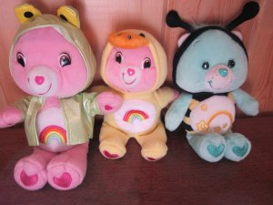 Three Care Bears in Costume Wish Bear Bee Cheer Bear Frog and smaller duck