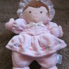 Prestige Pink plush Rattle Doll with flowers and brown hair