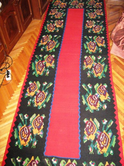 Antique Romanian rug from Northern Transylvania - red-black background