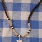Black and White Puka Shell Shark Tooth Necklace