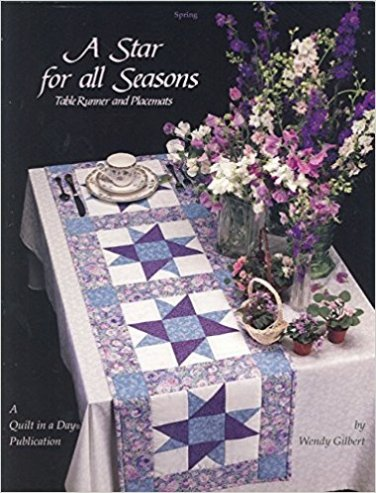 A Star for All Seasons: Table Runner and Placemats (Quilt in a Day Series) Paperback � May 1, 1992