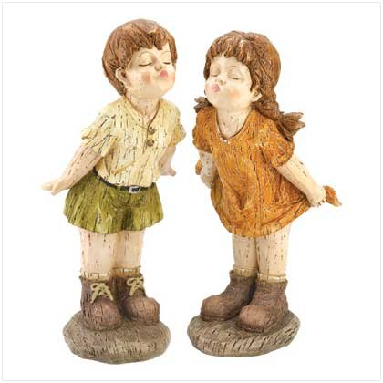 Our First Kiss Statues