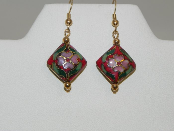 Pink Flowers on a Red Backround with a Diamond Shape