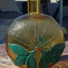 Honey colored or a very light brown painted bottle type or flask neat looking