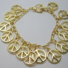 Metal Peace charms bracelet - gold tone