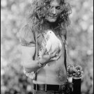 Robert Plant holding a dove that flew into his hands Black & White Poster 13x19