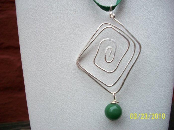 sterling pendant,green bead on green ribbon