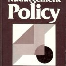 MANAGEMENT POLICY MELVIN J. STANFORD