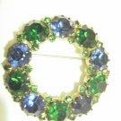 Karu signed wreath brooch green and blue Rhinestone