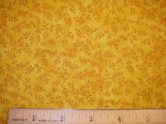 1.5 yard - Gold moddled fabric with dark gold vines