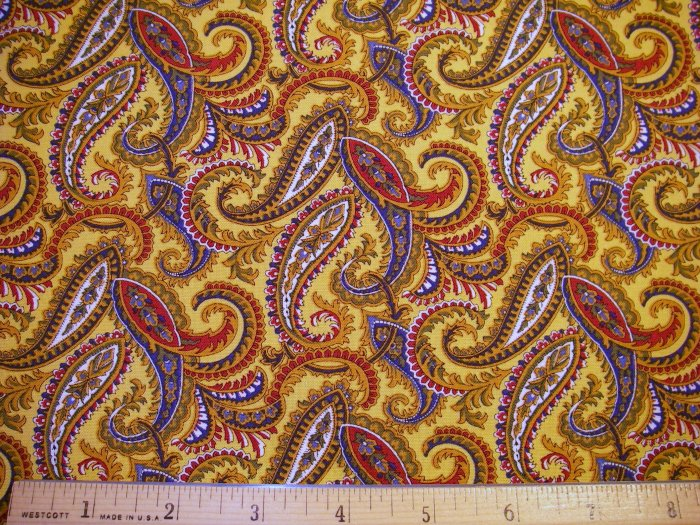 1 yard - Gold fabric with red, blue, white and olive paisley designs - Faye Burgos