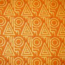 1.33 yards - Orange fabric with yellow accents and black specks