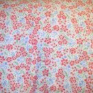 2.5 yards - White flannel with tiny red and blue flowers and green leaves all over fabric