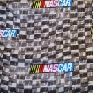 1 yard - Grey, white and black design with NASCAR logo on fabric