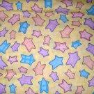 1 yard - Pastel stars on pale yellow fabric