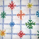 1.875 yards - Bright colored snowflakes on white fabric