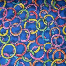 1 yard - Bright rings on medium blue fabric - Pink, Orange, Yellow, red, purple, green