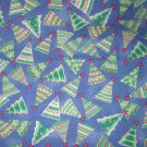 1.33 yards - Trees on blue fabric - Red, green, blue