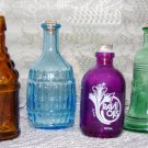 BEAUTIFUL! Lot Of 4 COLLECTIBLE GLASS BOTTLES Great for WINDOW DISPLAYS!