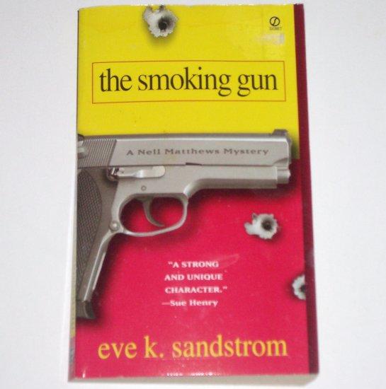 The Smoking Gun by EVE K SANDSTROM A Nell Matthews Mystery 2000