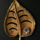Signed Kramer RhinestoneTLC Goldtone leaf pin