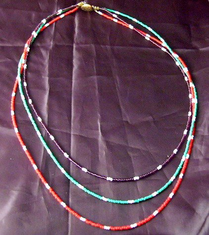 Hip on this 3 layer multicolor vintage Love  bead necklace