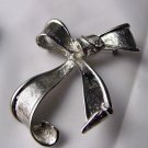 Free Flowing Silvertone Metal Pin Bow ribbon