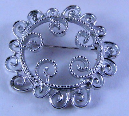 Sarah Coventry Filigree swirl circle pin Silvertone