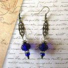 Cobalt Blue Faceted Crystal and Art Nouveau Style Filigree Charm Bronze Earrings