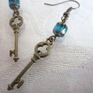 Clover Cutout Key Charms and Blue Cathedral Bead Antique Bronze Tone Earrings