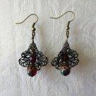 Handmade Dark Bronze Filigree Flower and Red Picasso Czech Glass Bead Earrings.