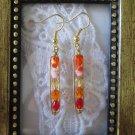 Handmade Orange Cream Fire Polish Glass in Hammered Frame Gold Tone Earrings