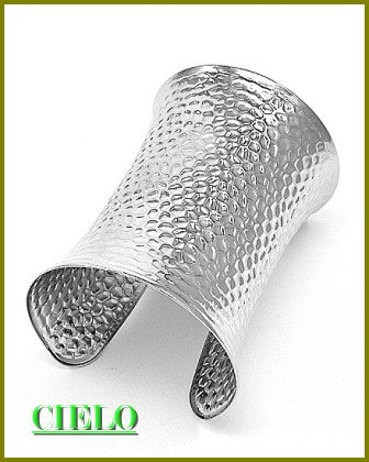 CIELO COUTURE wide distinctive hammered fashion bracelet on sale.