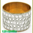 A posh costume bracelet provides dazzling unique silver bangle details with goldtone lining.