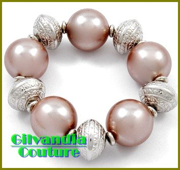 Stretch costume bracelet featuring silver tint and chocolate brown acrylic pearls.
