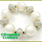 Stretch costume bracelet featuring white faux pearls and fine details.