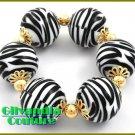 Costume bracelet flaunts a casual safari look with fantastic stones and fine metalwork.