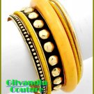 Boutique bracelet highlights your wardrobe with colorful theme and fine metalwork.