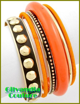 Costume bracelet highlights your wardrobe with colorful theme and fine metalwork.