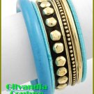 Costume bracelet features the antique colorful theme and fine metalwork.