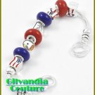 A boutique bracelet with silvertone with dark multi colored glass stones for your wrist.