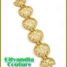 A fabulous boutique bracelet broadcasting topaz rhinestones and Fleur De Lis motif.