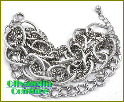 A wonderful display of textured chains and sparkle is yours with this boutique bracelet.
