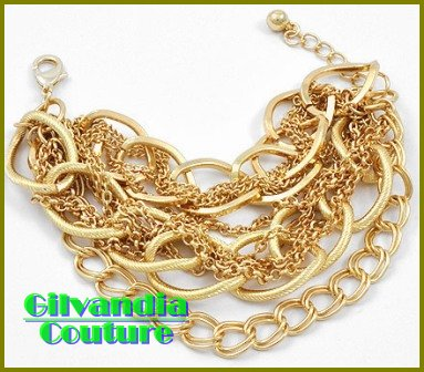 A gorgeous fashion bracelet with tons of goldtone and layers of textured chains.