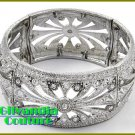 A stretch boutique bracelet that flaunts silvertone finish, rhinestones with filigree theme.