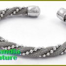 This fashion-forward boutique bracelet begins with rhodiumtone mesh and fine metalwork.