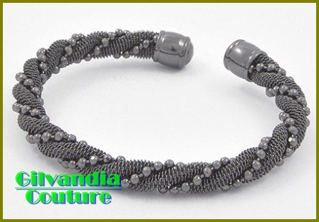 This couture boutique bracelet flaunts with smoketone mesh and fine cable metal work.