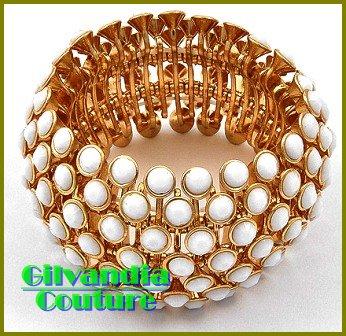 Designer inspired bracelet flaunts a gold finish and Kar�rat!® acrylic white stones.