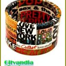 Ladies bracelet flaunts a multi colored paper art work design.