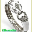 Ladies bracelet features clear ice rhinestones with white epoxy and animal motif.